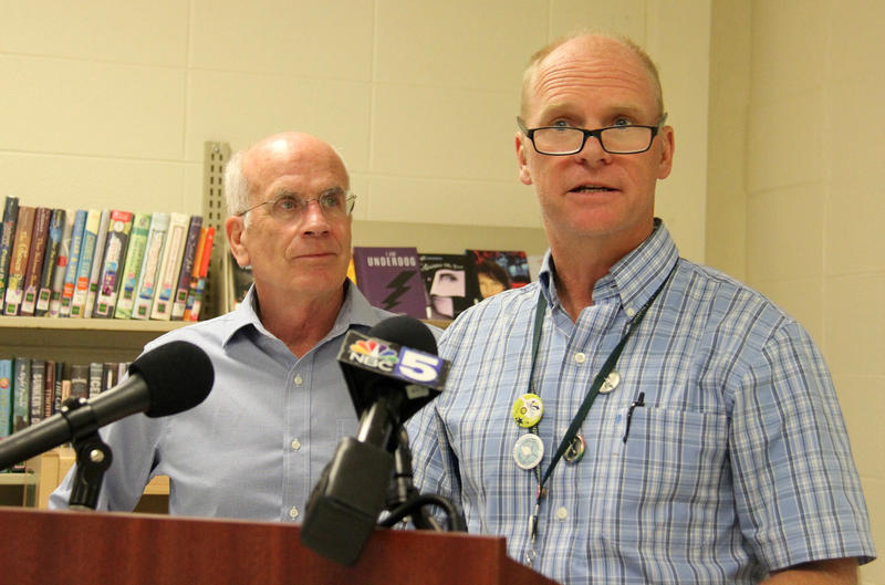 At a news conference with Rep. Peter Welch (left), Winooski Superintendent of Schools Sean McMannon said proposed cuts to federal education funding would hurt Winooski's summer education programs designed to help low-income families.