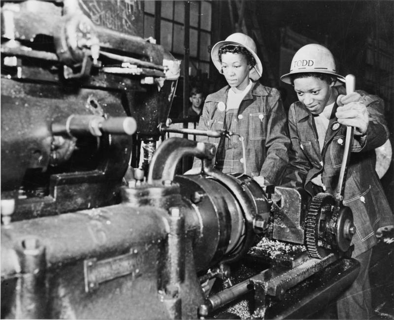 Martha Bryant and Eulalie Hampden operating a bolt cutting machine