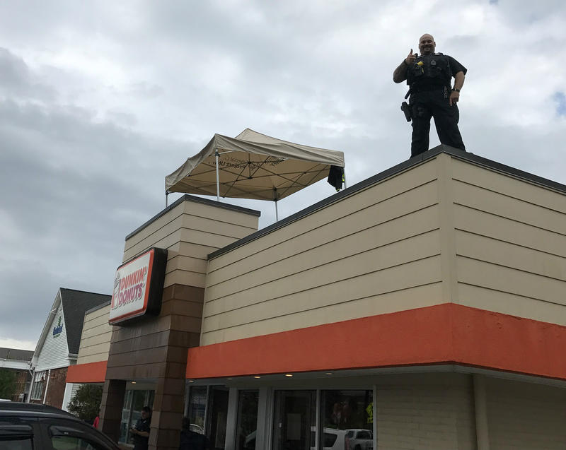 Winnoski Police Officer Derrick Kendrew greeted customers at the Colchester Dunkin' Donuts location Friday as part of an event to raise money for the Special Olympics.