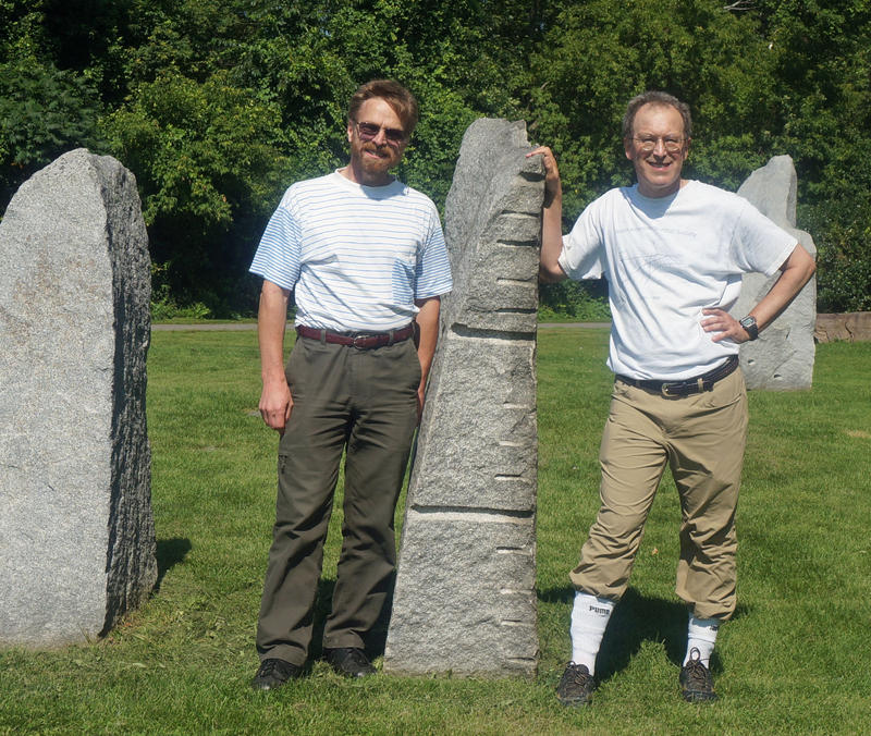EclipseSundial.com creators Dan Axtell (left) and Bill Gotesman pose at the Burlington Earth Clock, along the bike path. Gottesman also designed the sundial at the center of the stone circle.