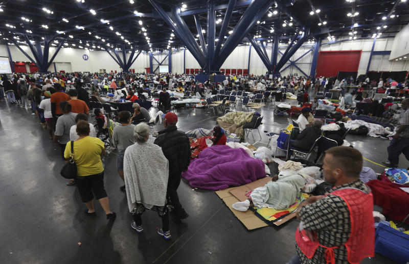 The George R. Brown Convention Center in Houston, Texas, pictured here on Tuesday, has become a shelter for people displaced by flooding caused by Harvey.