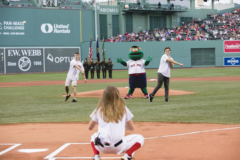 St. Michael's College graduates Danny Divis, left, and Justin McKenzie, right, throw out first pitches at the Boston Red Sox's