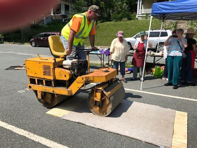 A steamroller substitutes for a traditional press in a Catamount Arts printmaking workshop in St. Johnsbury taught by Boston-based printmaker and Northeast Kingdom summer resident Julia Talcott.