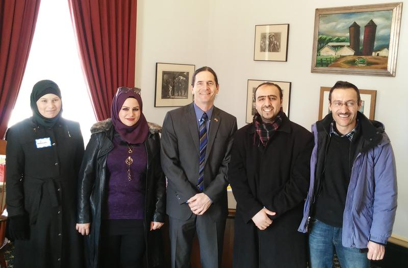 Lt. Governor Zuckerman with two Syrian families resettled in Vermont.