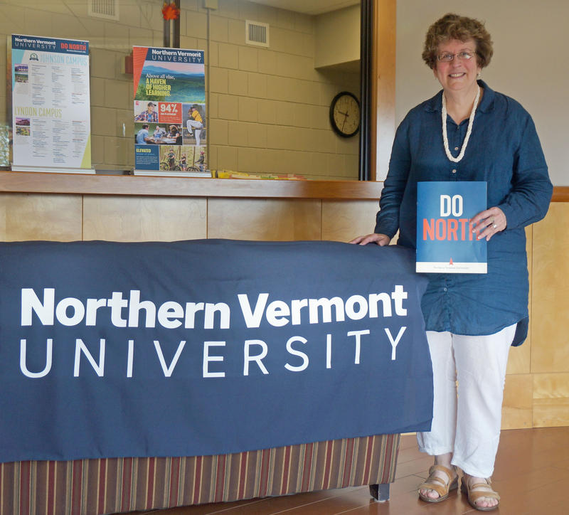 President Elaine Collins poses with some of the new marketing materials for Northern Vermont University in the Lyndon State admissions office.
