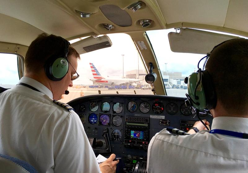 Cape Air Captain Jonathon Coste, left, supervises First Officer William Smith on a recent flight from Boston to Lebanon, New Hampshire.
