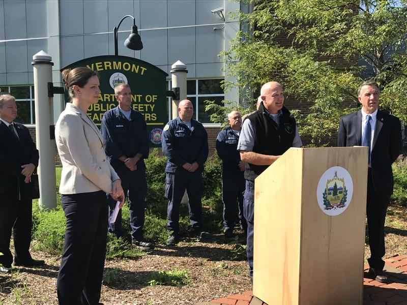 Michael Cannon, at podium, addresses the media Tuesday morning in Waterbury after his water rescue team returned from assisting with flood recovery in Texas.