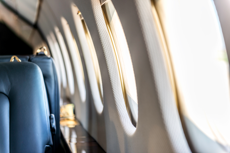 If you have a window seat while flying and need to get up, plan on doing so when others in your row are out of their seats.