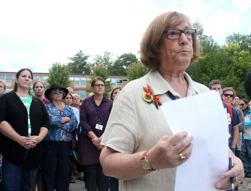 Burlington Education Association President Fran Brock, who teaches at Burlington High School, announced the union's decision to strike as teachers looked on after the union vote on Thursday, Sept. 7.