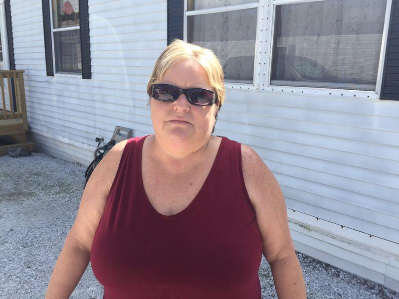Brenda Thibault stands in front of her mobile home at St. George Villa, where the residents are looking into forming a cooperative to purchase the park.