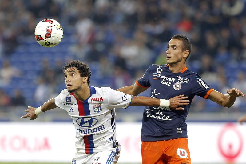 Montpellier's Ellyes Skhiri, right, vies for the ball against Lyon's Rafael Pereira Da Silva during a French League One game in Decines on Sept. 21, 2016. The Montpellier soccer team is sending a shipment of misspelled jerseys to Montpelier, Vermont.