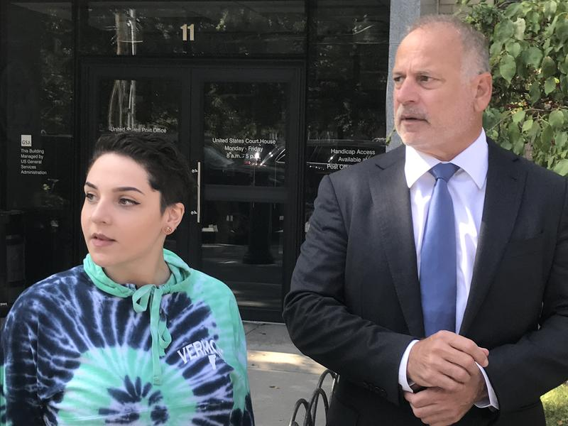 Lauren Morrissey, left, is suing Norwich University. She appeared alongsider her lawyer, Jeff Herman, outside Burlington federal court Tuesday.