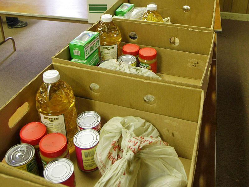 Boxes of food are seen being prepared for distribution in Enosburg Falls, Vt., in this Nov. 18, 2010 file photo. An estimated one-fourth of Vermonters will receive some form of food assistance this year.
