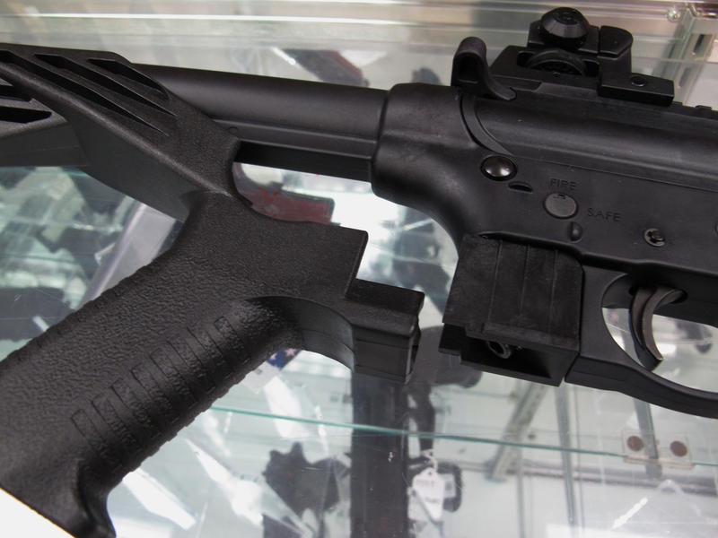 "This Feb. 1, 2013, file photo shows a ""bump stock"" next to a disassembled .22-caliber rifle at North Raleigh Guns in Raleigh, N.C. A similar device was used by the gunman in Las Vegas who killed 58 people"