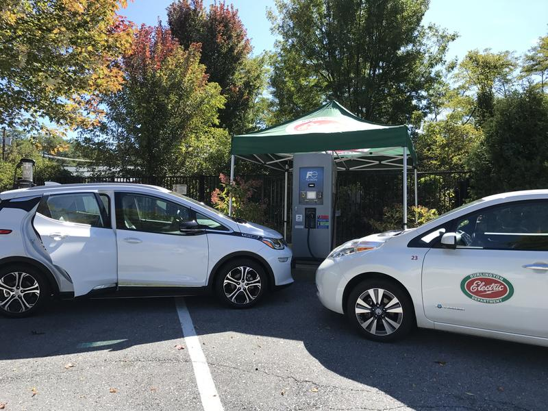 Electric vehicles and a charging station in Burlington, where utilities and car dealerships announced new incentives for electric cars on Tuesday.
