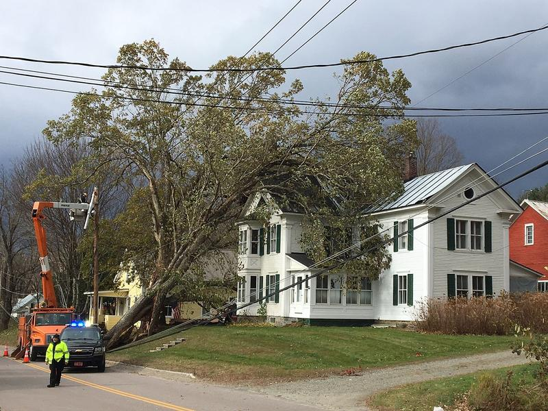 Workers from Stowe Electric tend to damage from a fallen tree on Moscow Road Tuesday. Utility officials say the scope of the damage from Sunday's storm has complicated recovery efforts.