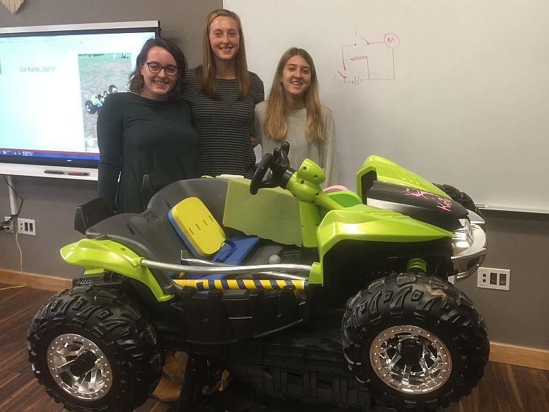 St. Michael's College students Sarah Hunzeker, Annie Ladue and Mia DelleBovi, left to right, are working on a project to convert toy cars into independent mobility devices for kids.