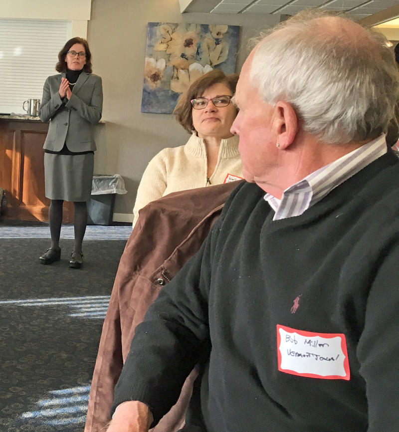Standing in the back of the room, VTDigger founder Anne Galloway answers questions at a Vermont Press Association meeting in Montpelier on Thursday.