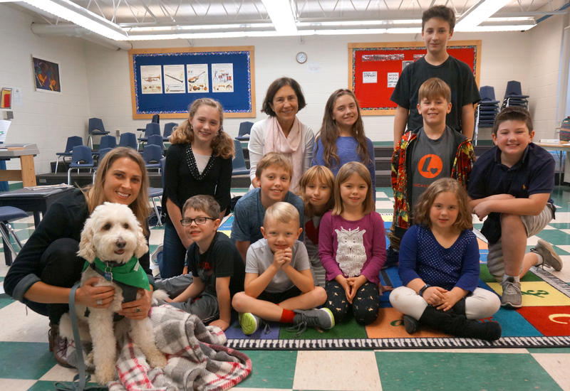 First and fifth grade reading buddies at Chamberlin School spent time with Sarah Genest and her therapy dog Hobie. The first graders read to Hobie during their visit. The fifth graders read about a dog like Hobie in 'When Friendship Followed Me Home.'