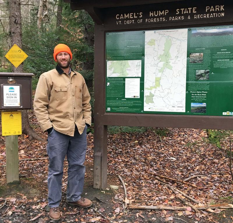 Vermont Department of Forests, Parks and Recreation Stewardship Forester Jason Nerenberg stands at the Monroe Trailhead at Camel's Hump State Park, in Duxbury.