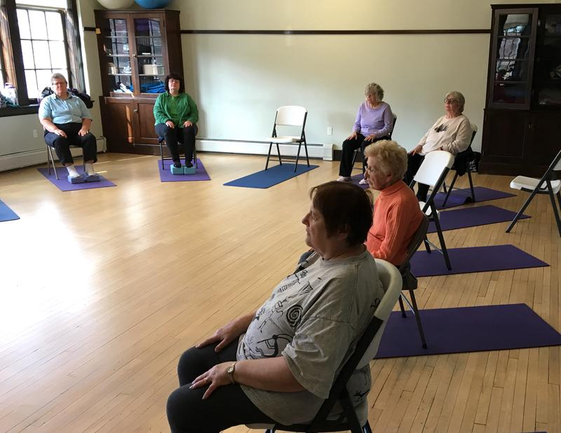 A yoga class at the Montpelier Senior Activity Center. The class' instructor, Sarah Parker-Givens, says the class offers many health benefits for students.