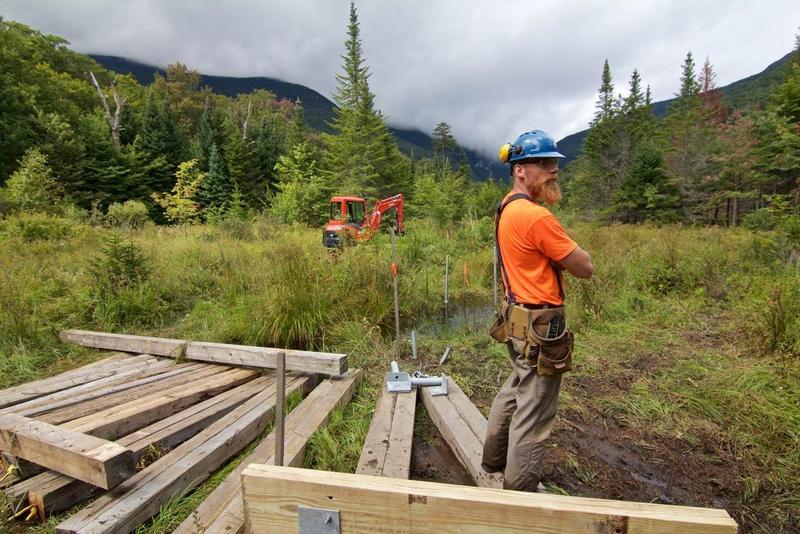 Josh Ryan surveys progress on construction of the boardwalk.