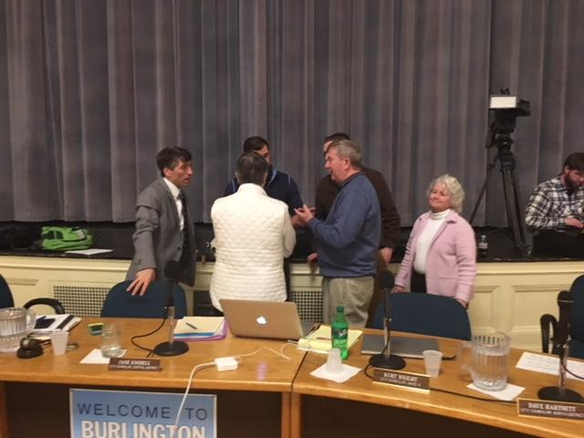Members of the Burlington City Council confer during a break in the meeting. The council voted 8 to 2 to select Schurz as the buyer for Burlington Telecom.