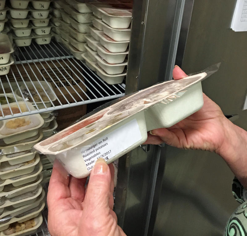 Twin Valley Senior Center Executive Director Rita Copeland shows how freezer meals are packaged for Meals on Wheels Delivery. The center lost nearly 400 meals when this freezer was knocked out after the recent wind storm.