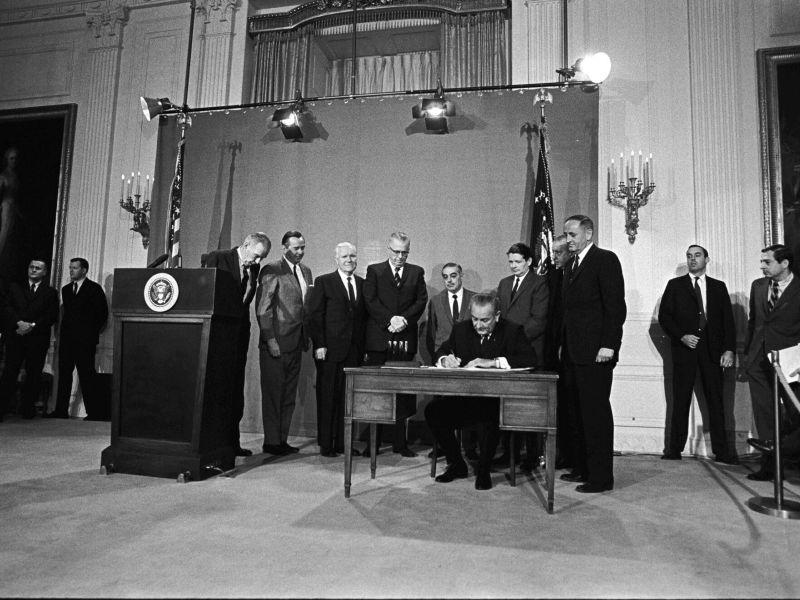 President Lyndon Johnson signing the Public Broadcasting Act in 1967.