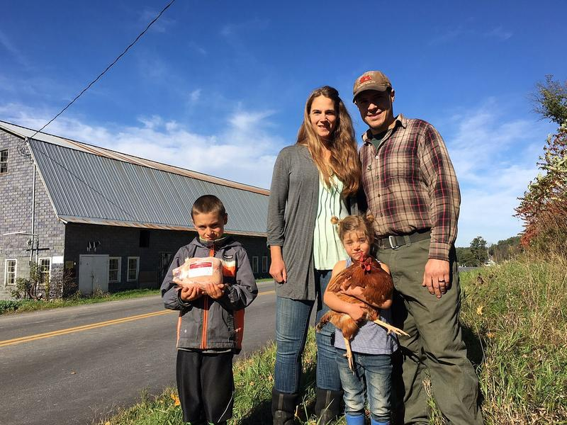 Sabrina and Lucas Papineau with their children, Jeremiah and Aubrey, at the Papineau Family Farm in Highgate Springs. The Papineaus say farming helped them reintegrate as a family after Lucas' deployment to Afghanistan in 2010..