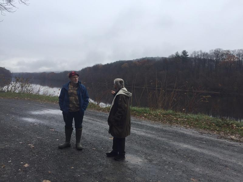 Former Fish & Wildlife board chairman Brian Ames, left, and photographer Candace Brown discuss who should be able to use the state boat launches while standing along the Connecticut River in Putney.