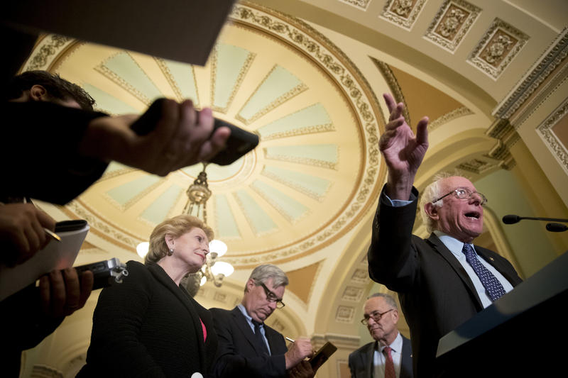"Sen. Bernie Sanders - pictured here on Capitol Hill on Oct. 17 with Sen. Debbie Stabenow, Sen. Sheldon Whitehouse and Senate Minority Leader Chuck Shumer - joins ""Vermont Edition"" to discuss key issues, including the proposed GOP tax plan."