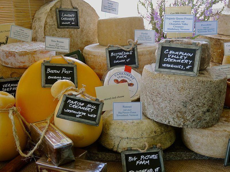 An array of cheeses is displayed at a cheese festival. Many Vermont cheeses have won national and international awards. Dr. Paul Kindstedt tells Vermont Edition why.
