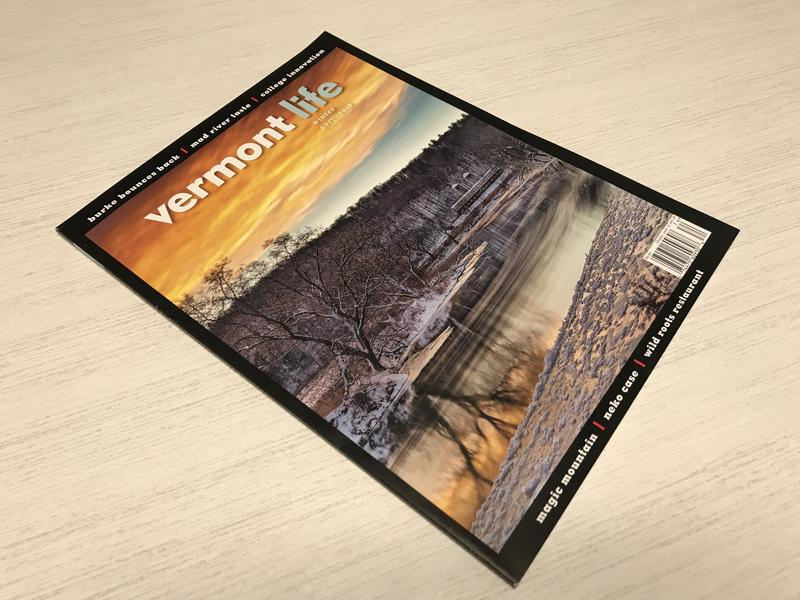 "The current issue of ""Vermont Life"" magazine on a table."