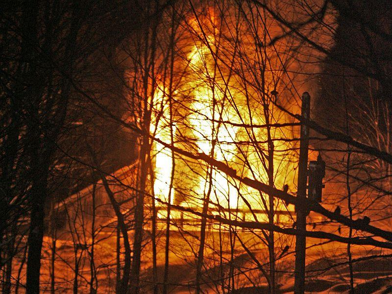 Winter house and barn fires, like this one in Worcester in January, 2009, present special challenges to Vermont's firefighters.