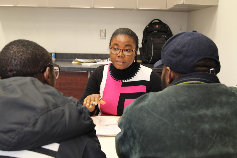 Migrant advocate Esther Guillaume helps arrange housing for two men from Nigeria who crossed illegally into Canada in November 2017.