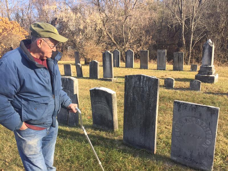 John Newton surveys his family's gravestones in the West Hartford Cemetery.
