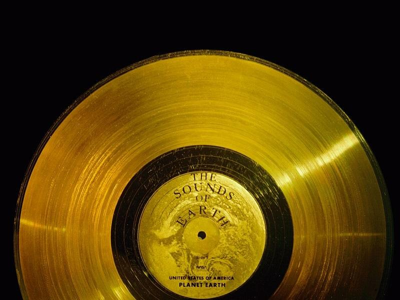 The Voyager Golden Record is a gold plated disc with audio and video information meant and designed to be read by intelligent species that might encouter it.
