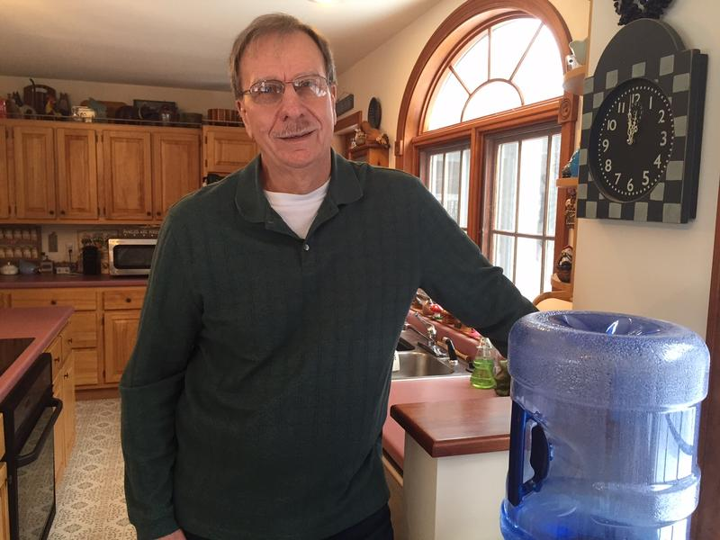 Bill Knight lives in Bennington and his water is contaminated with the chemical PFOA. A draft report says the contamination in his neighborhood cannot be linked to the company's work.