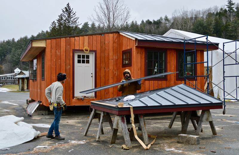Builders at Yestermorrow Design/Build School in Waitsfield, pictured here in December, finish building the roof on a cabin commissioned by the Vermont Huts Association.