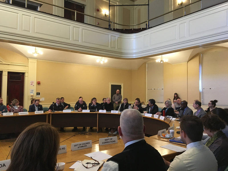 A meeting of the CommunityStat group at city hall in Burlington. The monthly meeting brings together police, public health, social services and city and state officials to coordinate their response to opioid addicition.