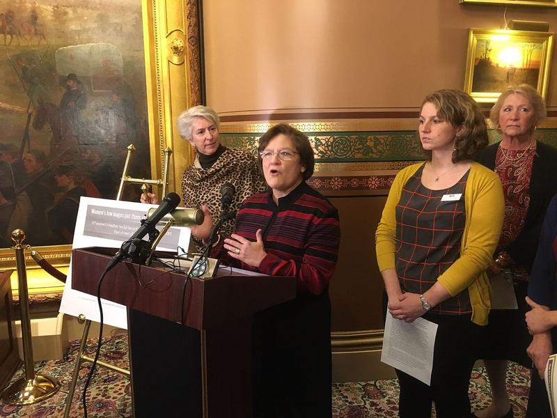 Sen. Debbie Ingram, at podium, was among several Vermont senators Friday to call for legislation that would ban employers from asking applicants about their salary histories.