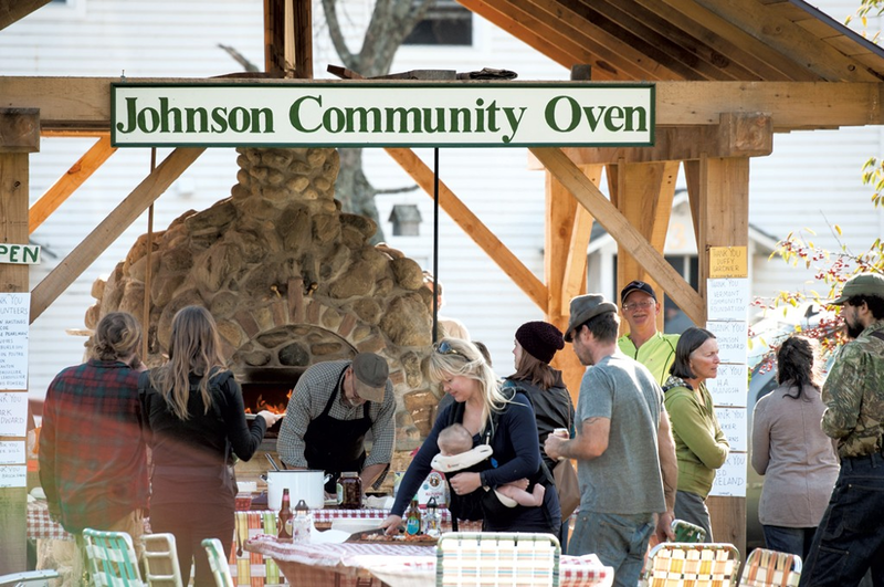 Residents of Johnson gather for the inaugural pizza-bake at the town's community oven in October, 2017.