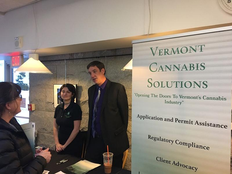 Tim Fair, center, talks to a prospective customer at a cannabis industry event in the Statehouse cafeteria Tuesday. Fair, a lawyer, says the legalization bill passed by lawmakers this week sets the stage for a more robust marijuana sector in the future.