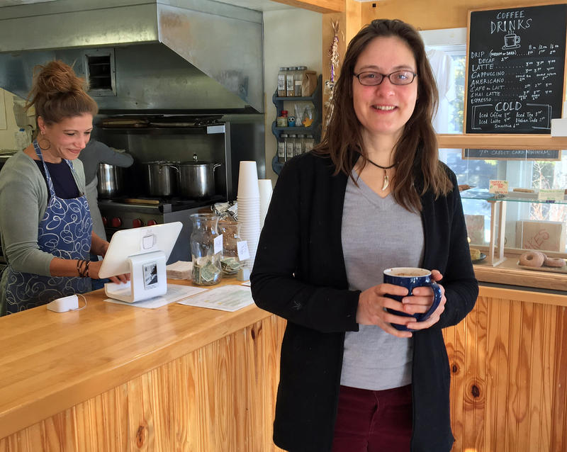 Jaiel Pulskamp gets a cup of coffee at the Post Office Cafe, in Worcester. In addition to working on her farm, she's a field organizer for 350 Vermont's Generate New Solutions Campaign to bring renewable energy discussions to town meetings across Vermont.