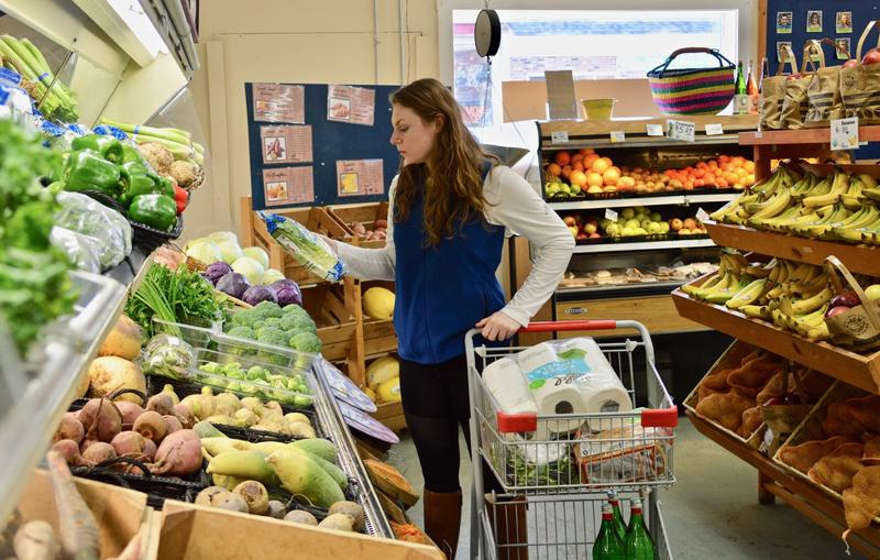 Emma Griffith, a concierge with Stock the House, shops at the Rutland Area Food Co-op for a client on a ski vacation in Killington. Stock the House got its start last year in New Jersey, and expanded to Vermont in November.