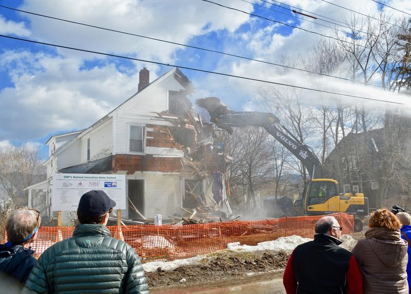 Dozens watched as crews began tearing down a dilapitated house in Rutland Monday. Green Mountain Power is teaming up with officials in Rutland and many local businesses to build a brand new energy efficient home that will be given away in a new contest.