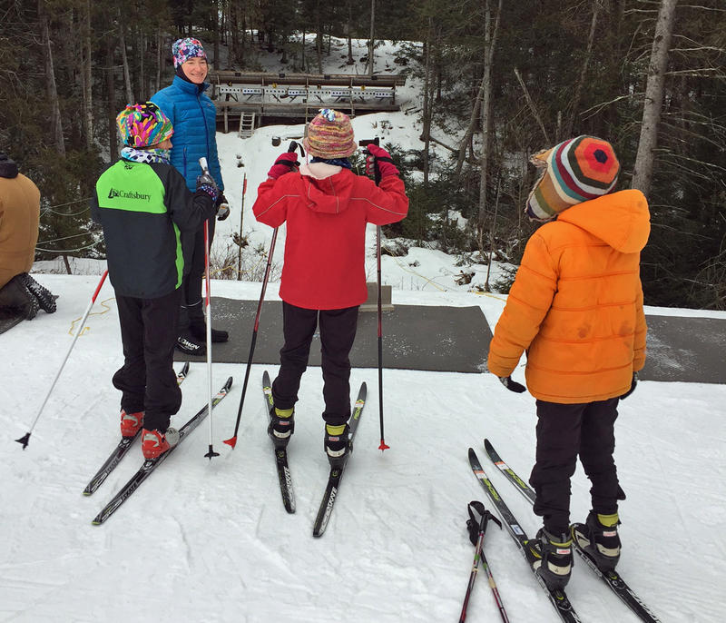 Hannah Dreissigacker introduces a group of young skiers to the Craftsbury Outdoor Center's shooting range.