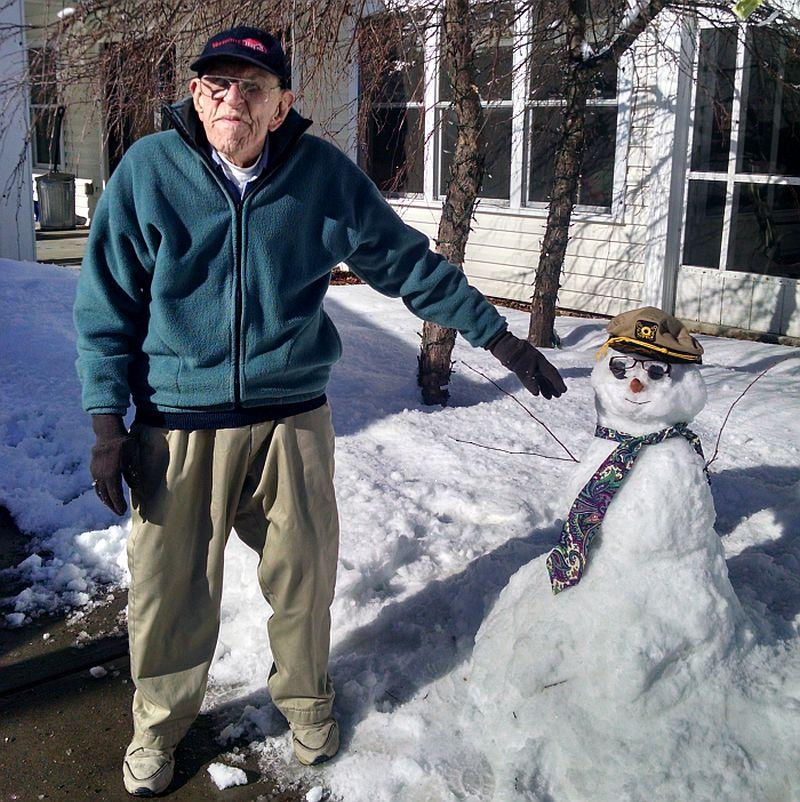 Warren Patrick of Townshend still has the energy to build a snowman in the middle of winter.