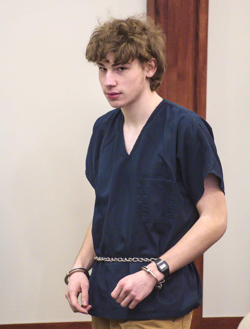18-year-old Jack Sawyer, of Poultney, enters Rutland Superior Court on Tuesday afternoon wearing handcuffs.